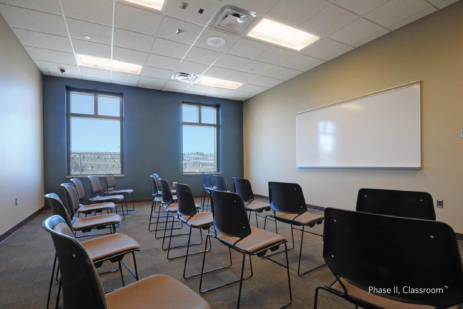 A sex offender facility classroom with moveable chairs.