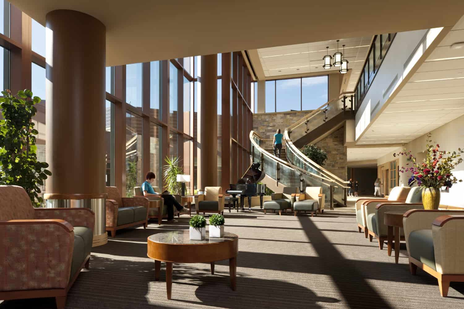 Maple Grove Hospital's lobby with people.