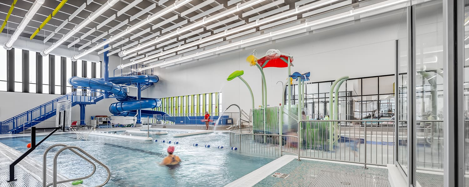 Children and adults alike enjoy the slides and pool equipment in the leisure pool area.