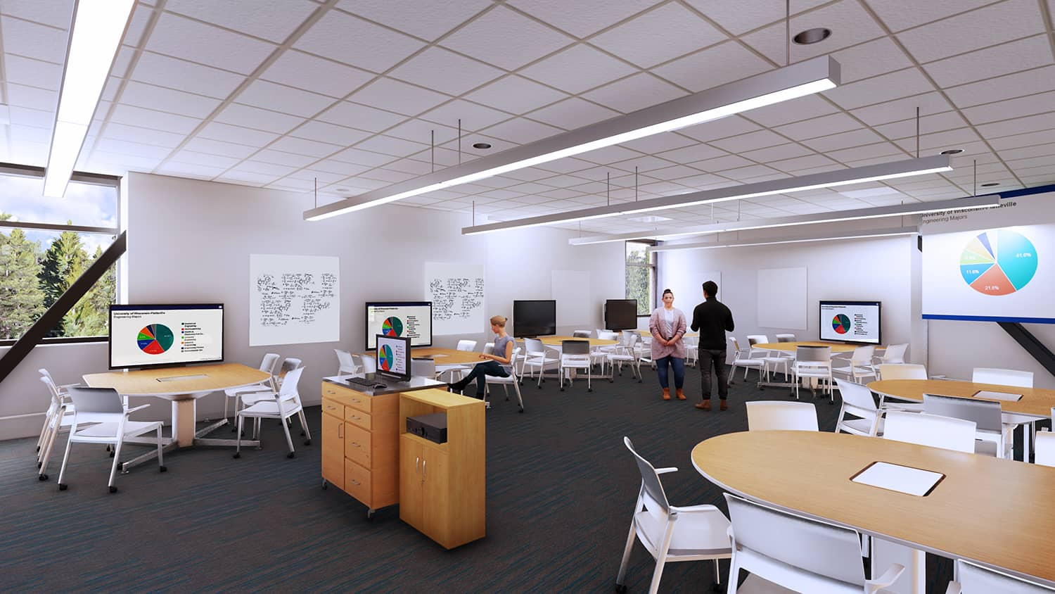 An active learning classroom with moveable furniture and monitor options.