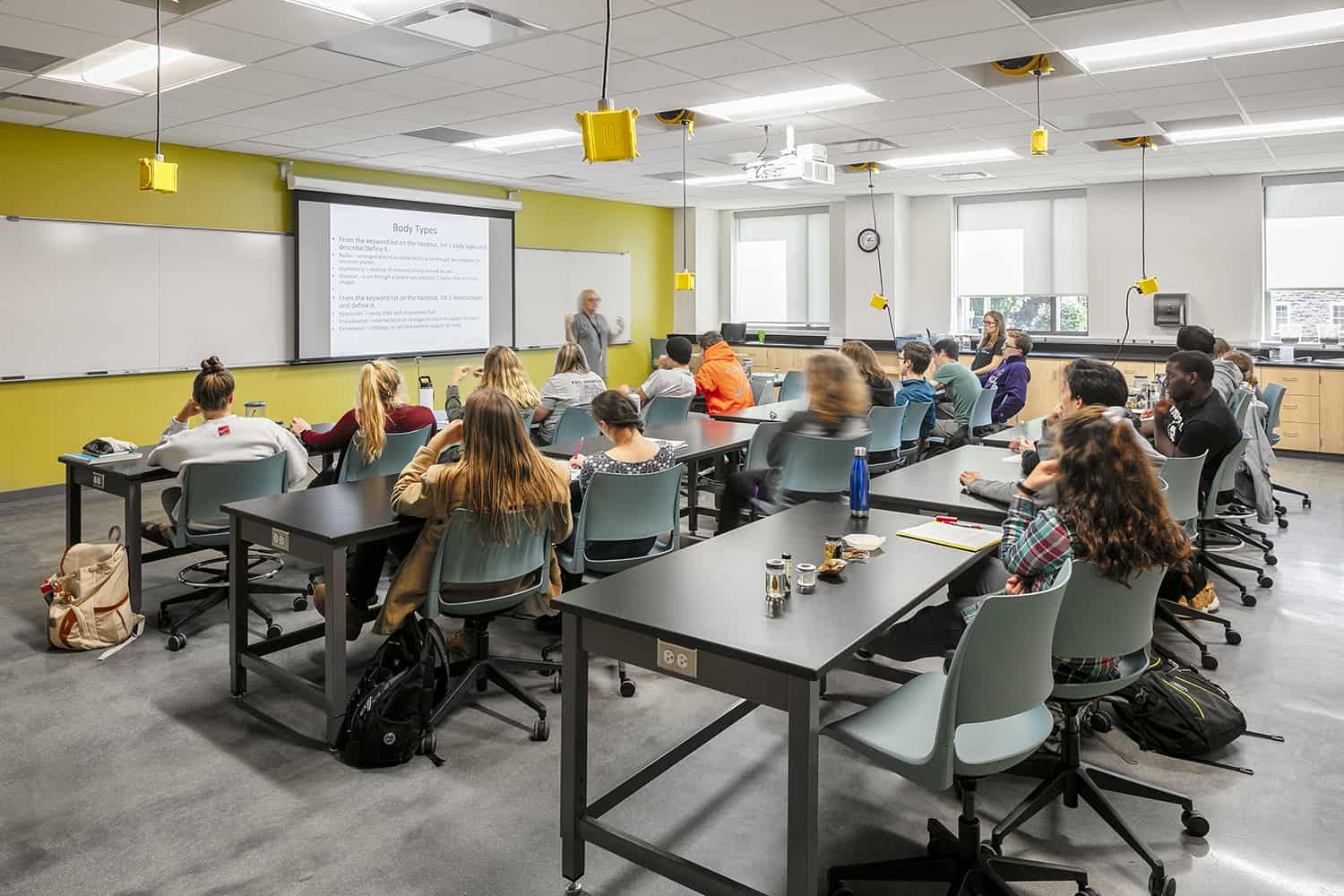 Students seated for a lecture in a biology classroom.