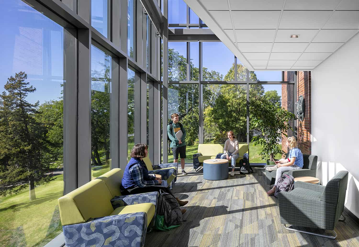 A daylit second floor lounge that offers expansive views to the historic campus.