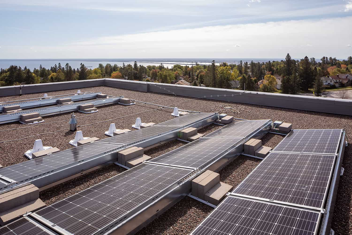 Rooftop solar panels and a view to Lake Superior.