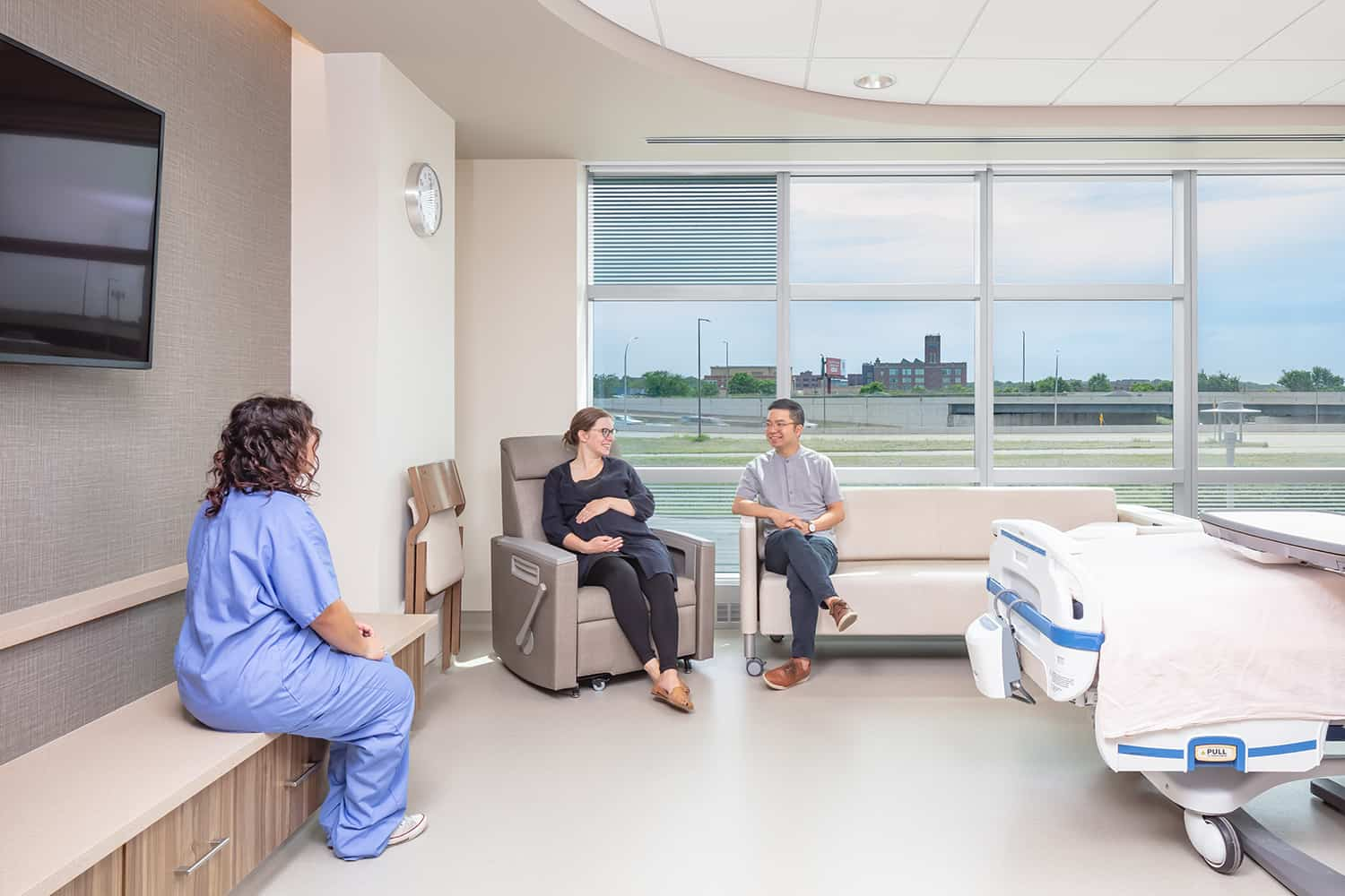 A family enjoying the seating space in a post op room.