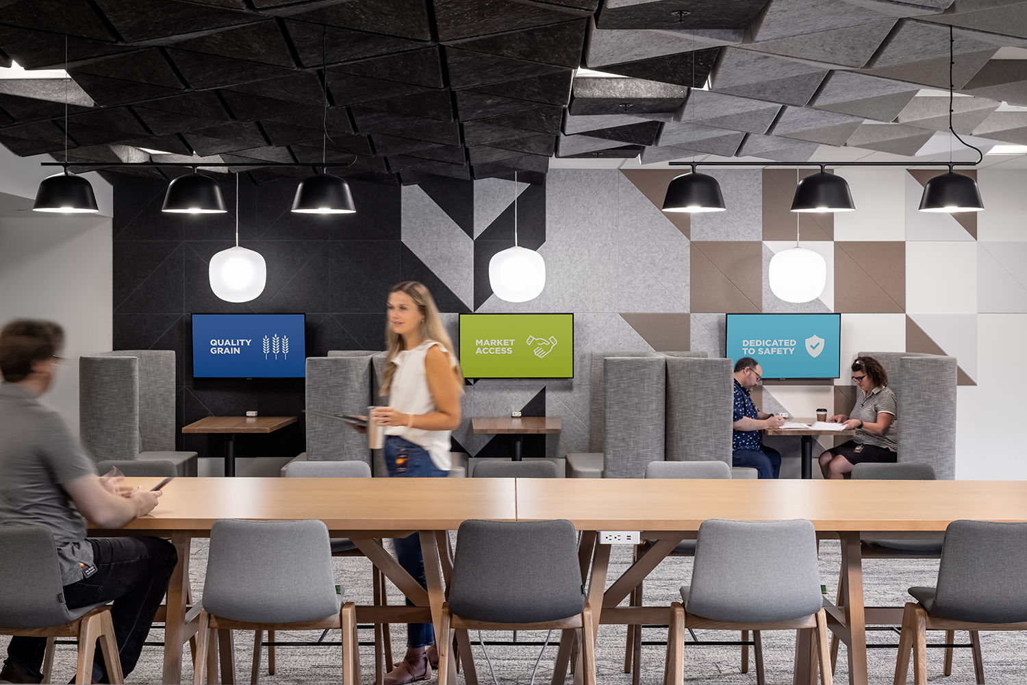 Detailed shot of the CHS work cafe with booth seating and accompanying technology.