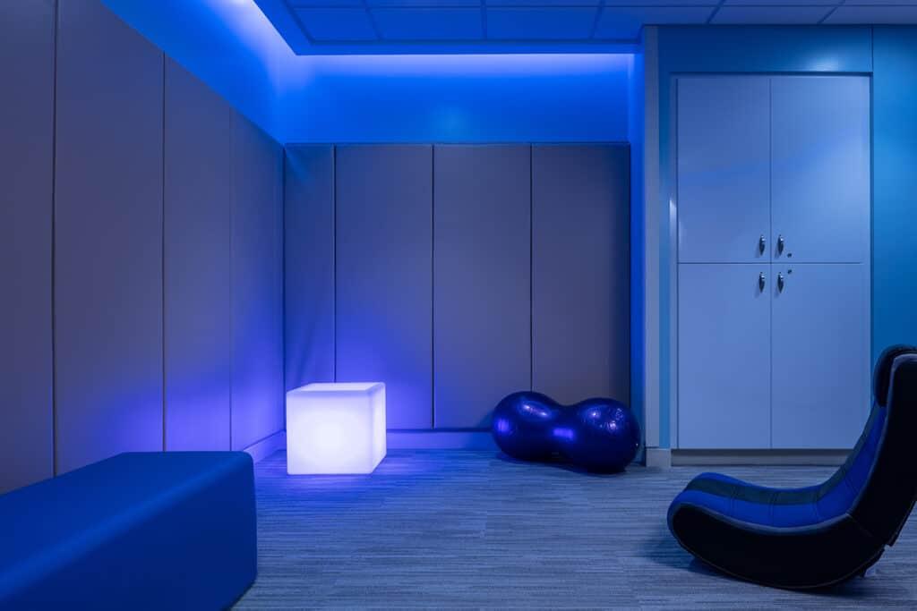 Sensory room with blue lighting.