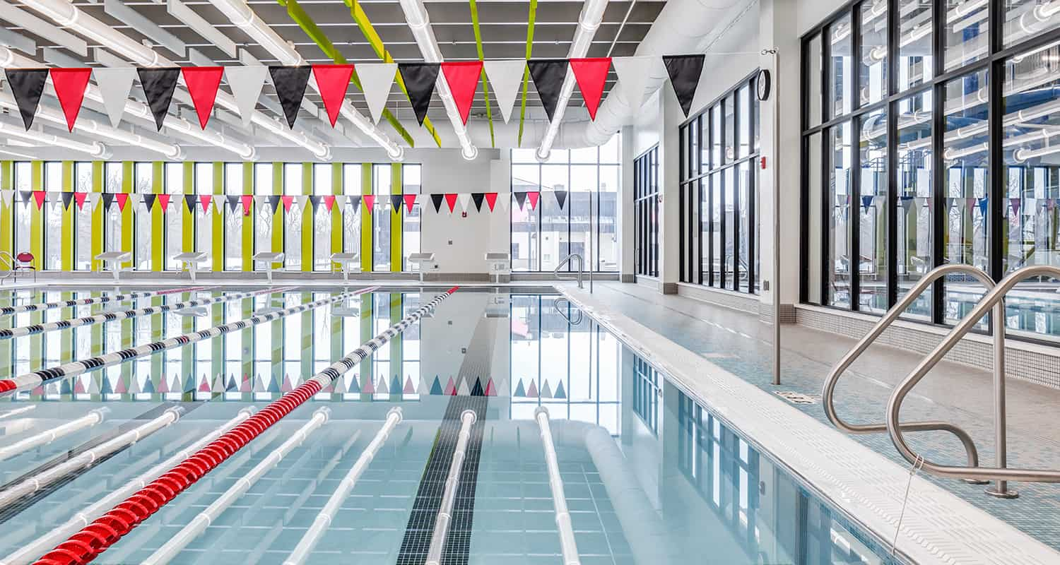 An open lap pool lets in natural daylight, as well as views to the adjacent leisure pool.