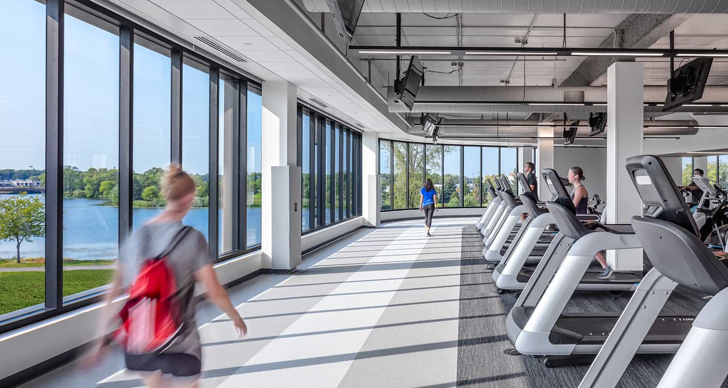The walking track is surrounded by large windows that overlook the local community.