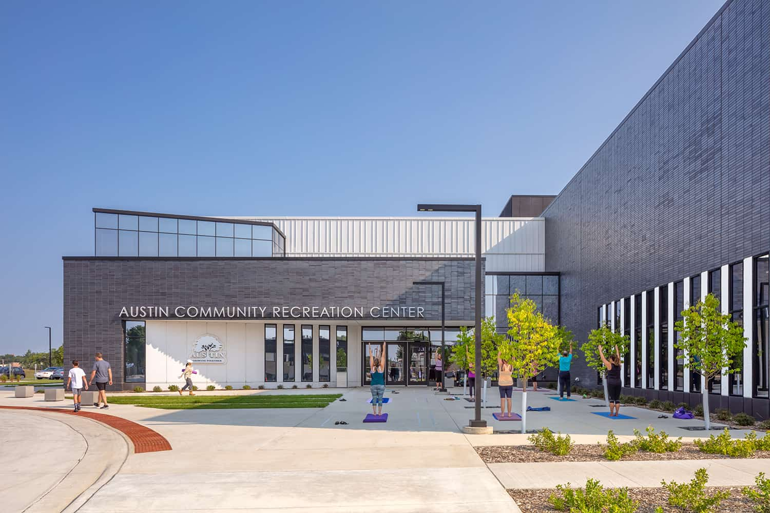 YMCA's front entry where patrons can participate in outdoor activities like group yoga.