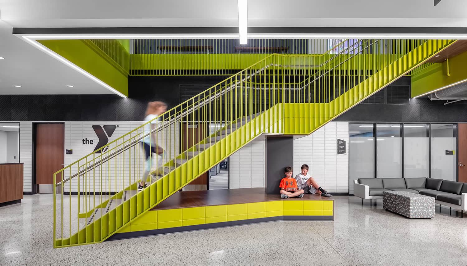 Main green stairwell with seating below.
