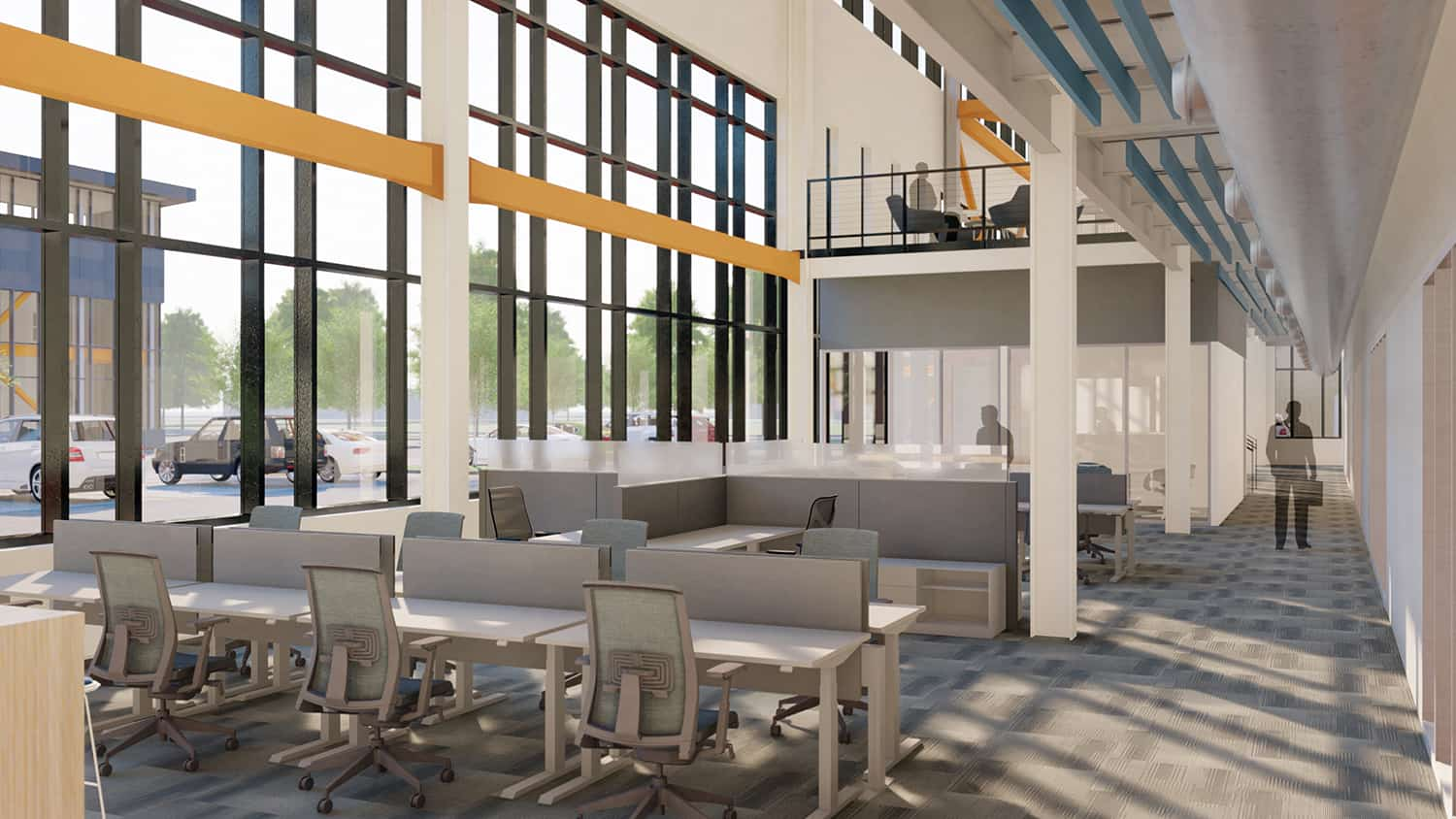 Open workstations with two-story windows and visual access to the second floor.