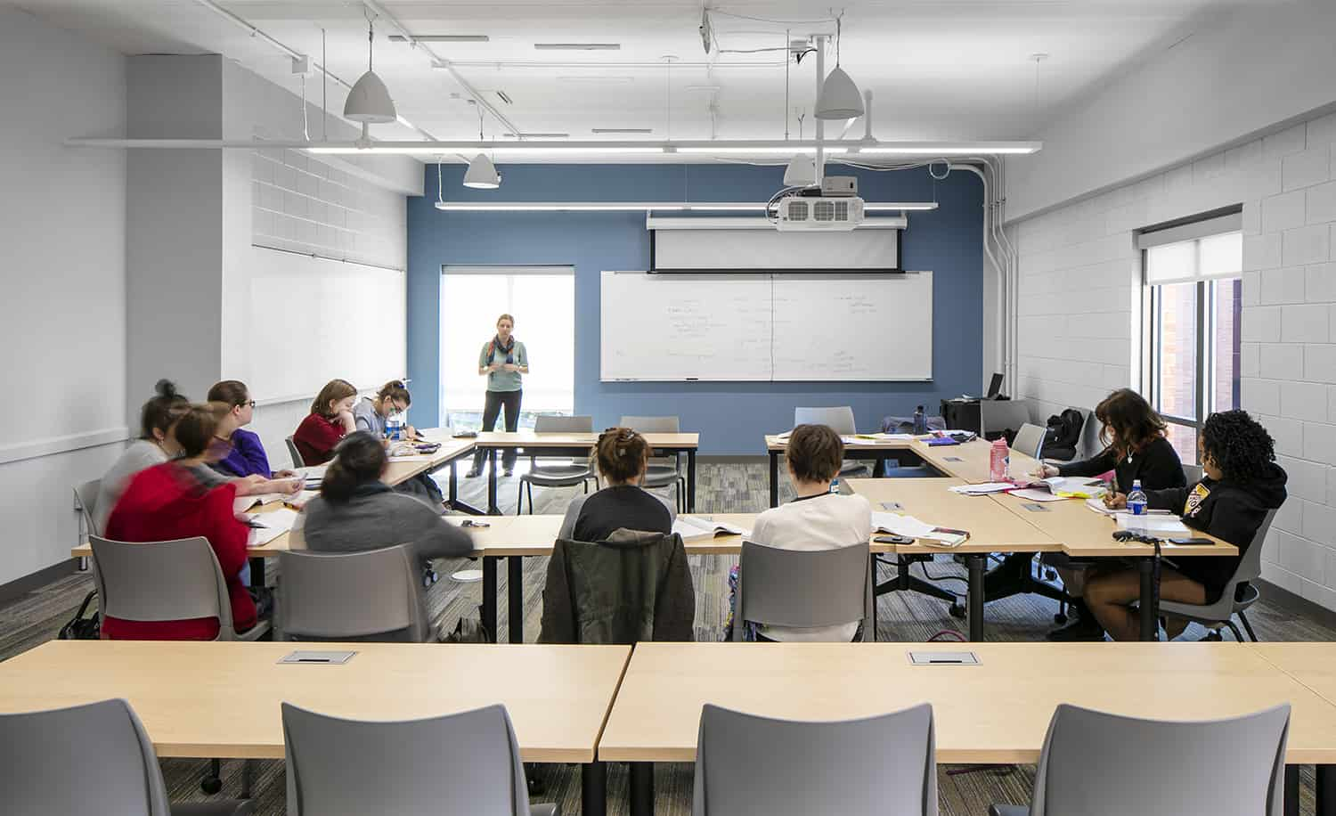 Students attending a lecture in a remodeled classroom.