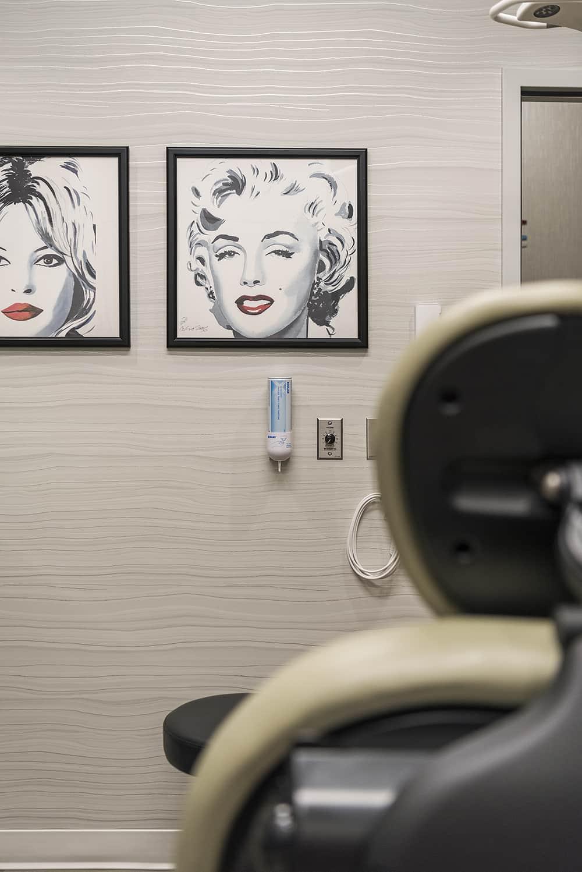 A detailed shot of a dermatology procedure room's wall art.