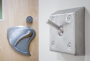 Detail images of code compliant door hardware and hooks.