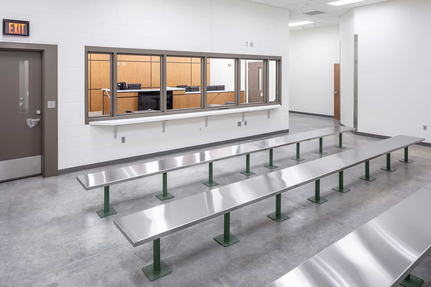 Waiting benches outside of the jail's courtroom.