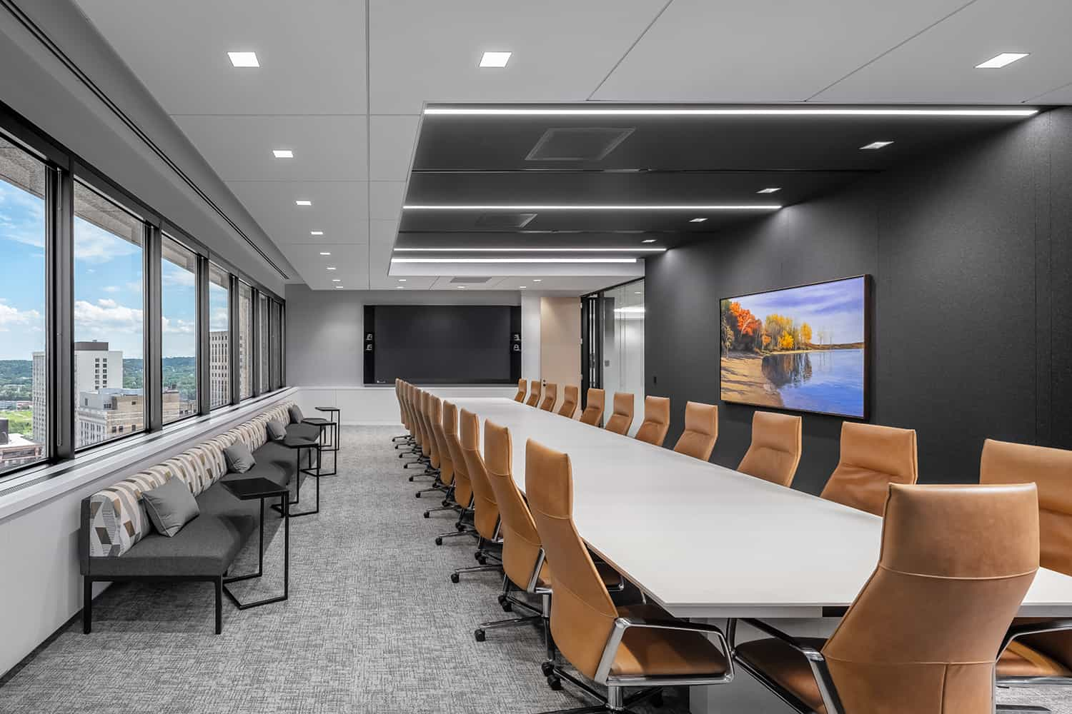 A boardroom with updated furniture, finishes, and technology to improve functions and comfort during meetings and events.