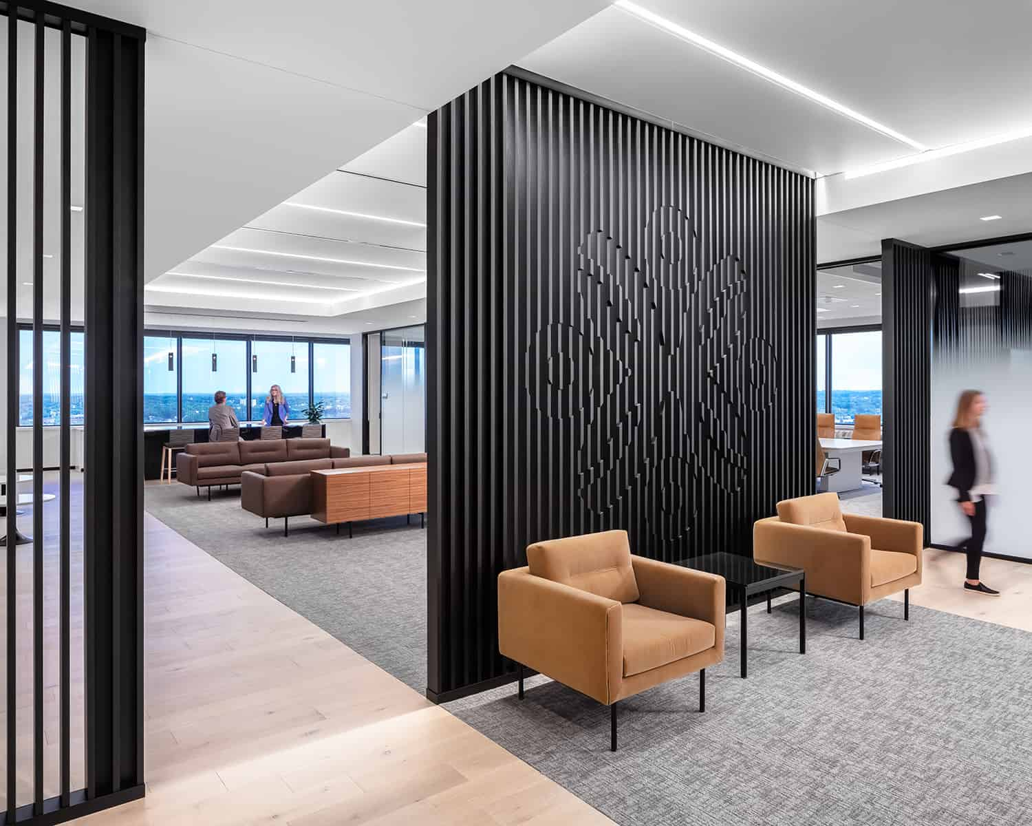 The entry to the leadership lounge cafe featuring a custom made slatted wall with an inset Securian logo.
