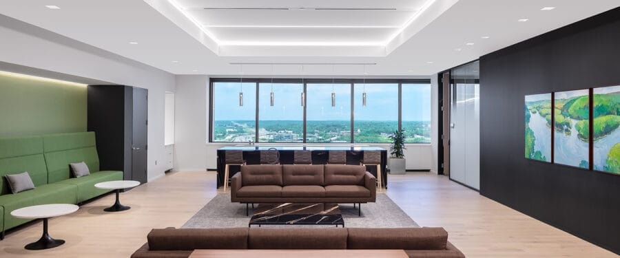 An open lounge cafe with access to expansive views and brand colors incorporated into the finishes.