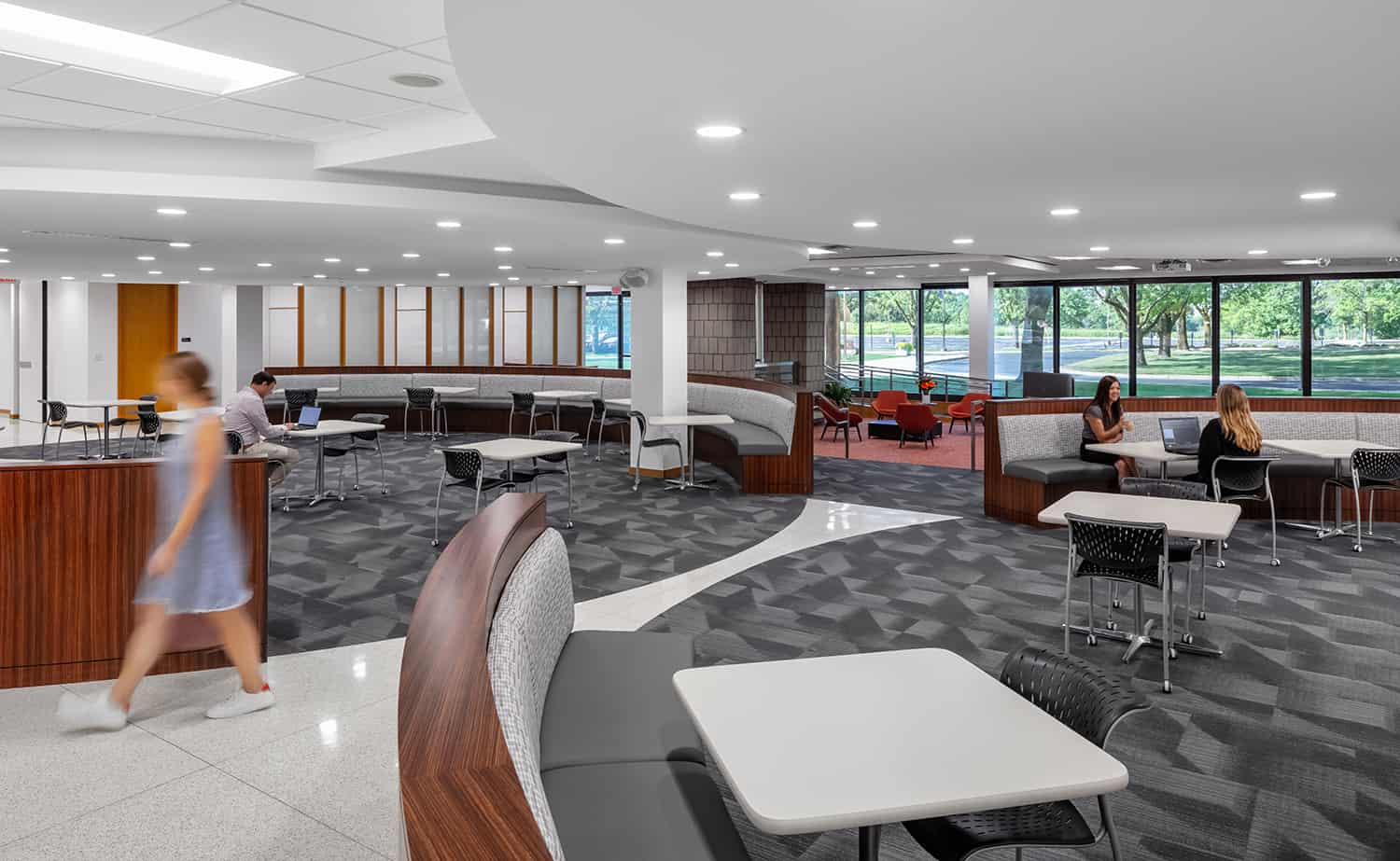 Open collaboration space with many drop-in booths and tables.