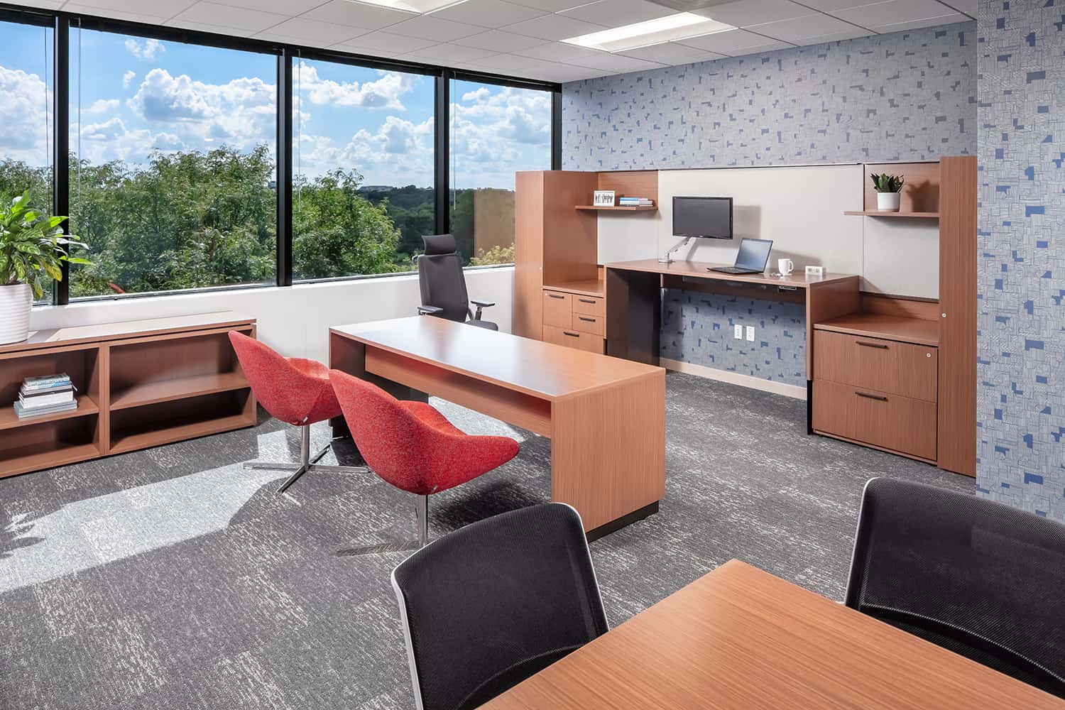 Private office with expansive window views and options for touchdown seating.