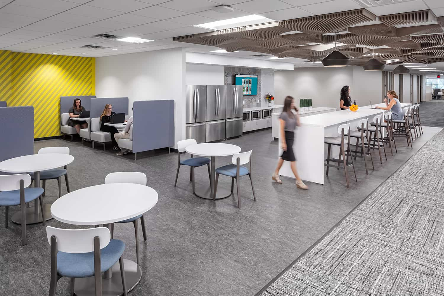 Work cafe with booths for focused conversations and open touchdown seating.