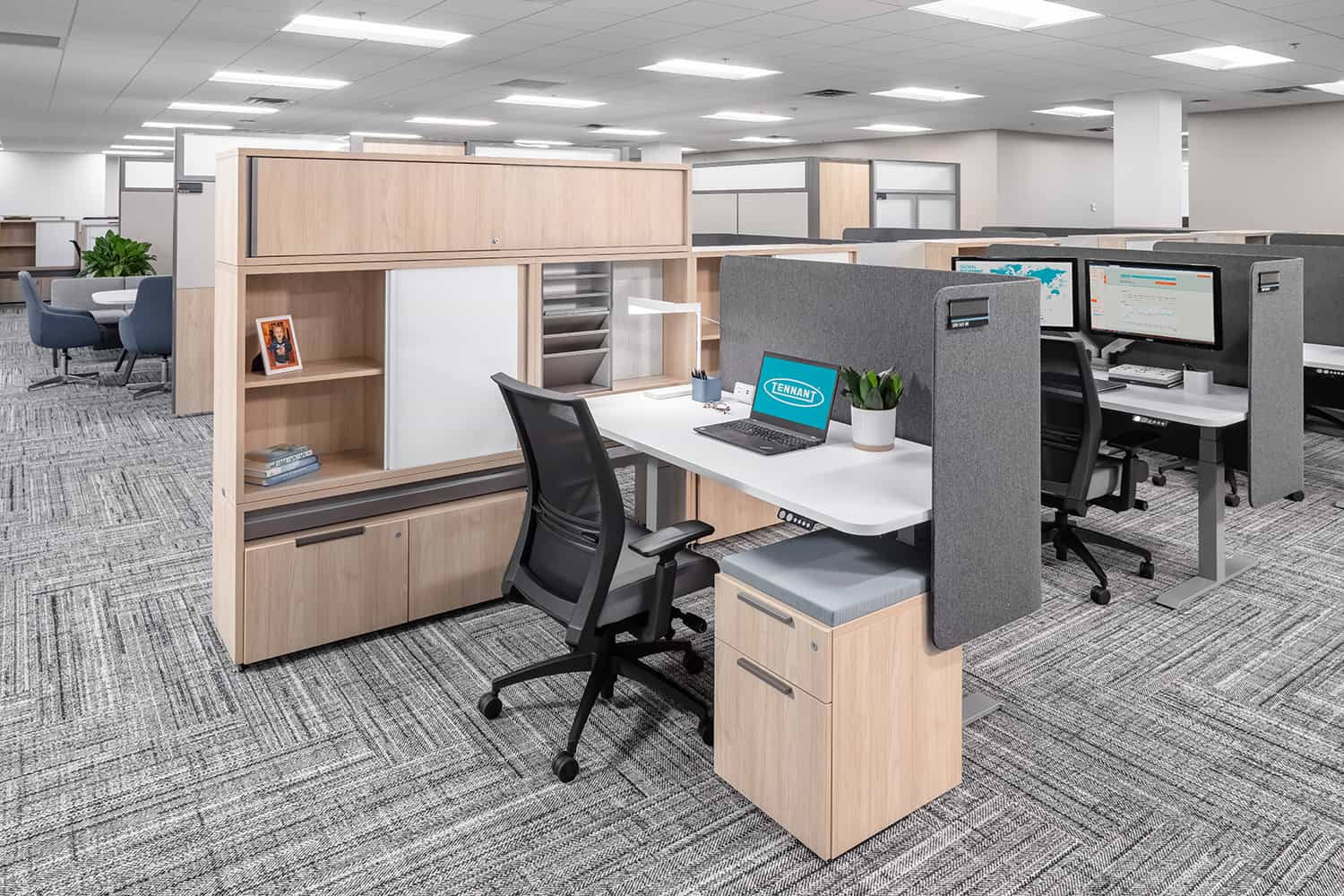 A semi-private cubicle workstation with a lowered desk.
