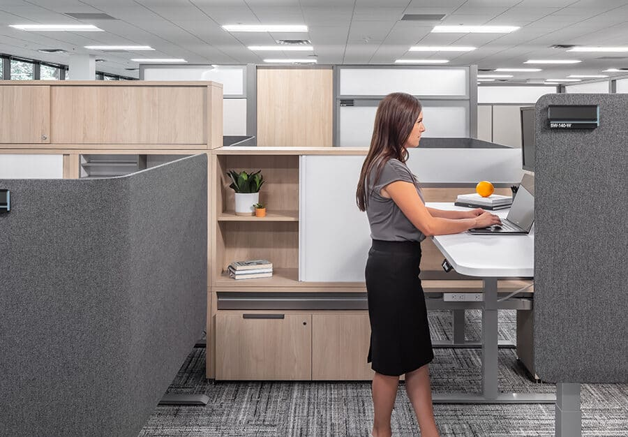 A semi-private cubicle workstation with a raised desk.