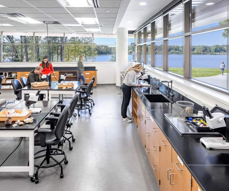 An ecology lab features wrap-around window views and high-tech equipment.