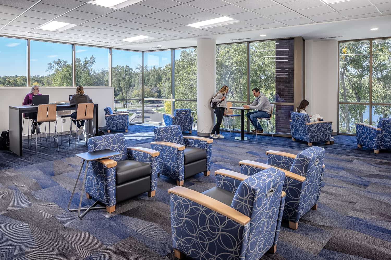 A lakeview lounge offers a quiet place for students to study together, complete with bar-height desk and comfortable armchairs.