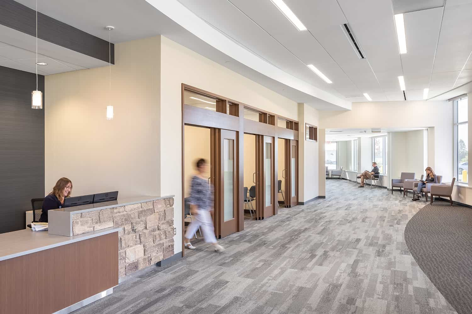 The new welcome desk offers a spacious waiting area and private check-in rooms.