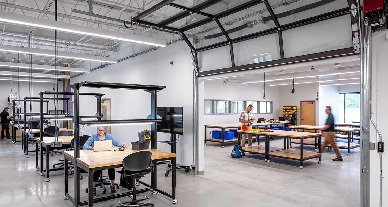 Rolling overhead garage doors create temporary separation between labs and workshops.
