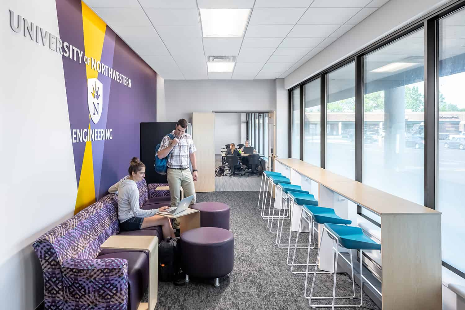 A branded breakout workspace in the entry to the engineering classroom facility.