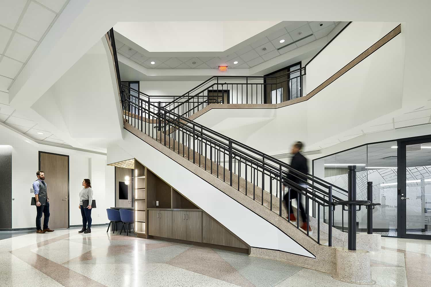 Overall view of the atrium and staircase in the office center.