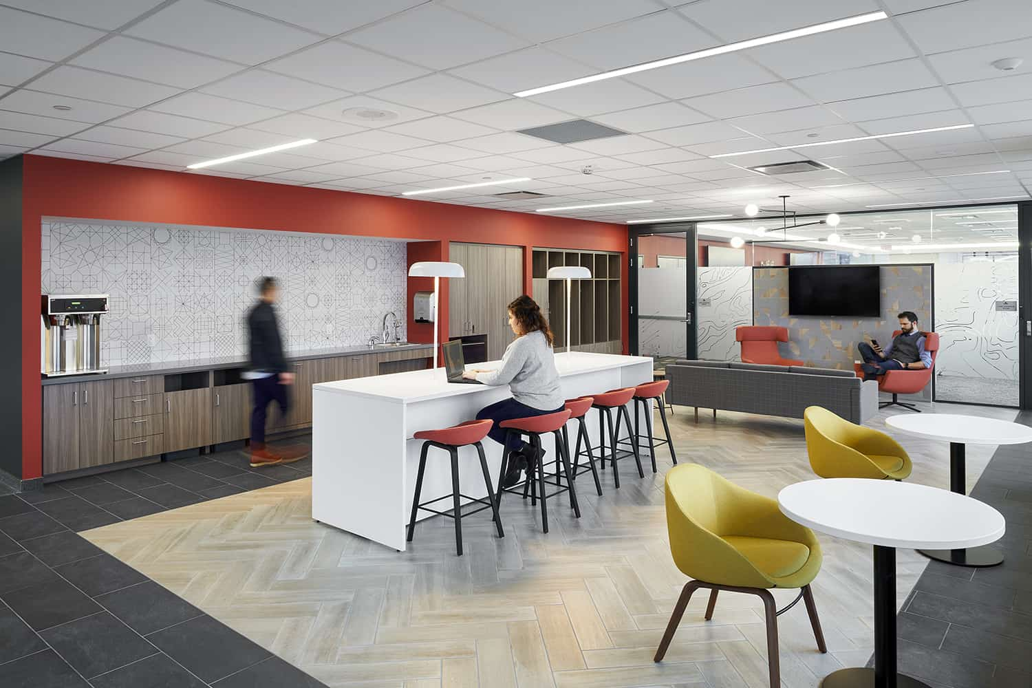 Staff flex space with seating options and branded color wall.
