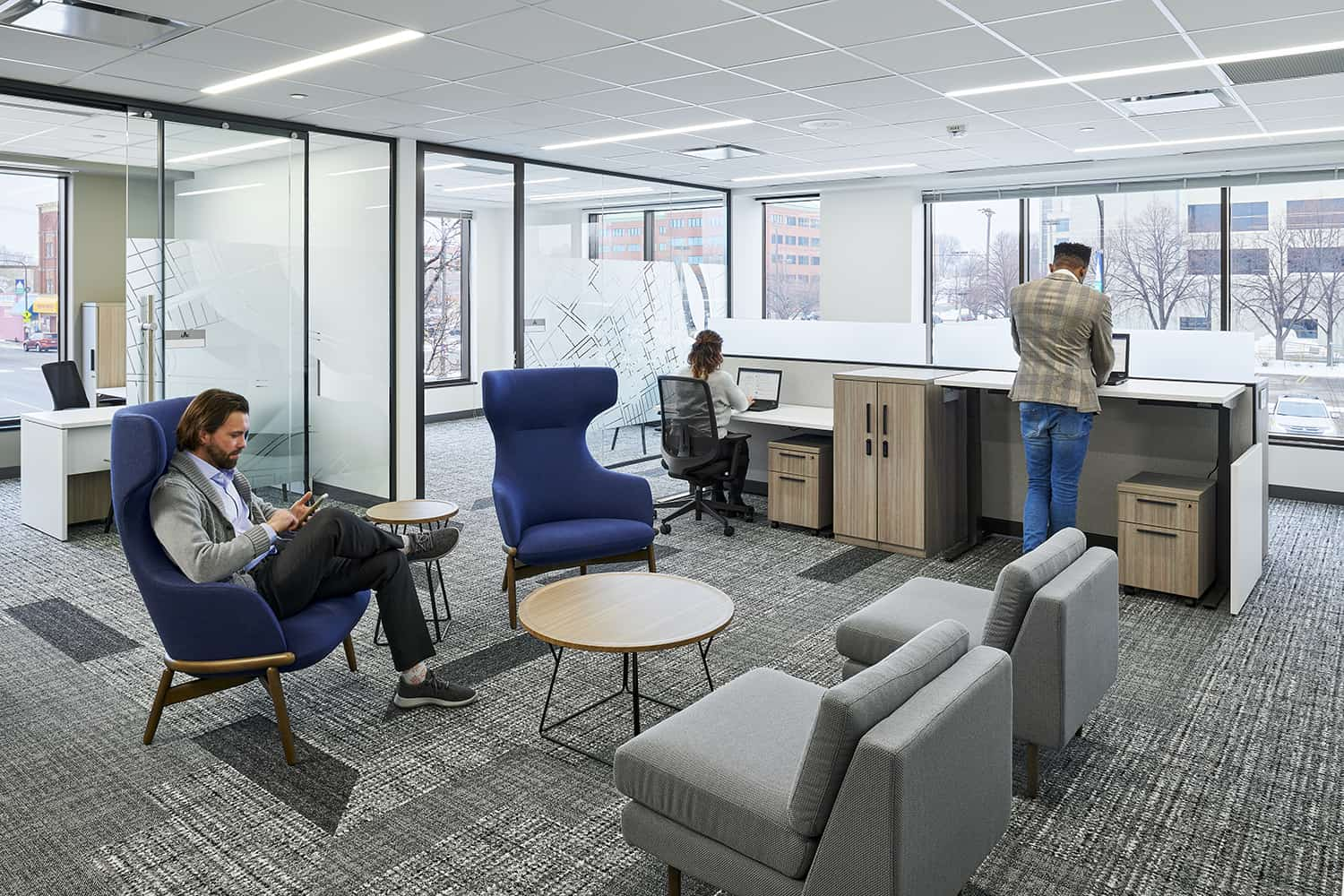Open touchdown space with blue furniture within an open office environment.