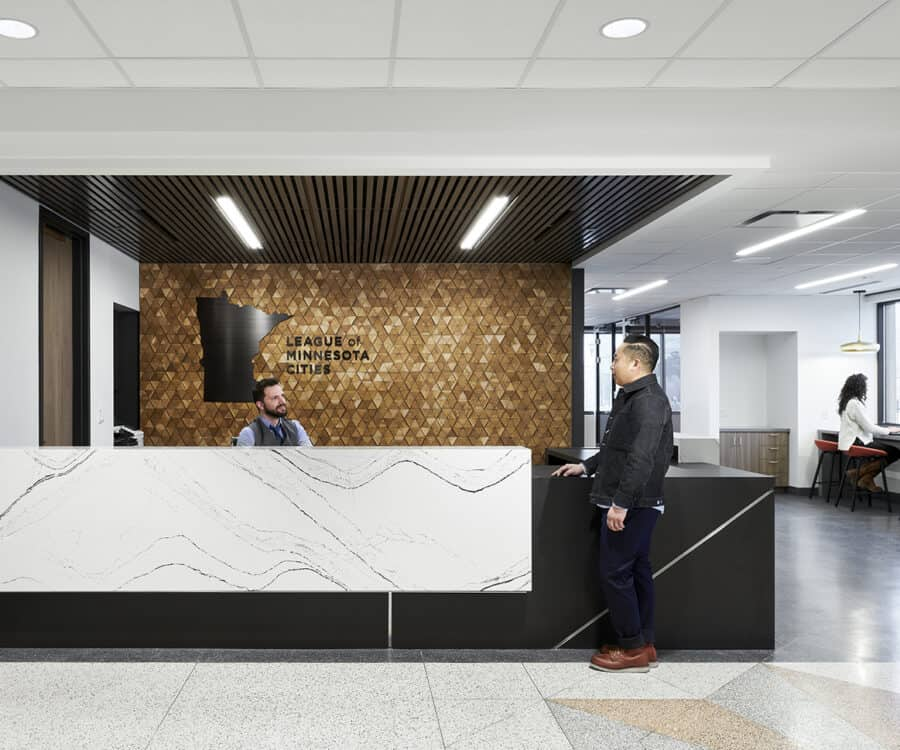 Front reception desk with accent wall and logo.