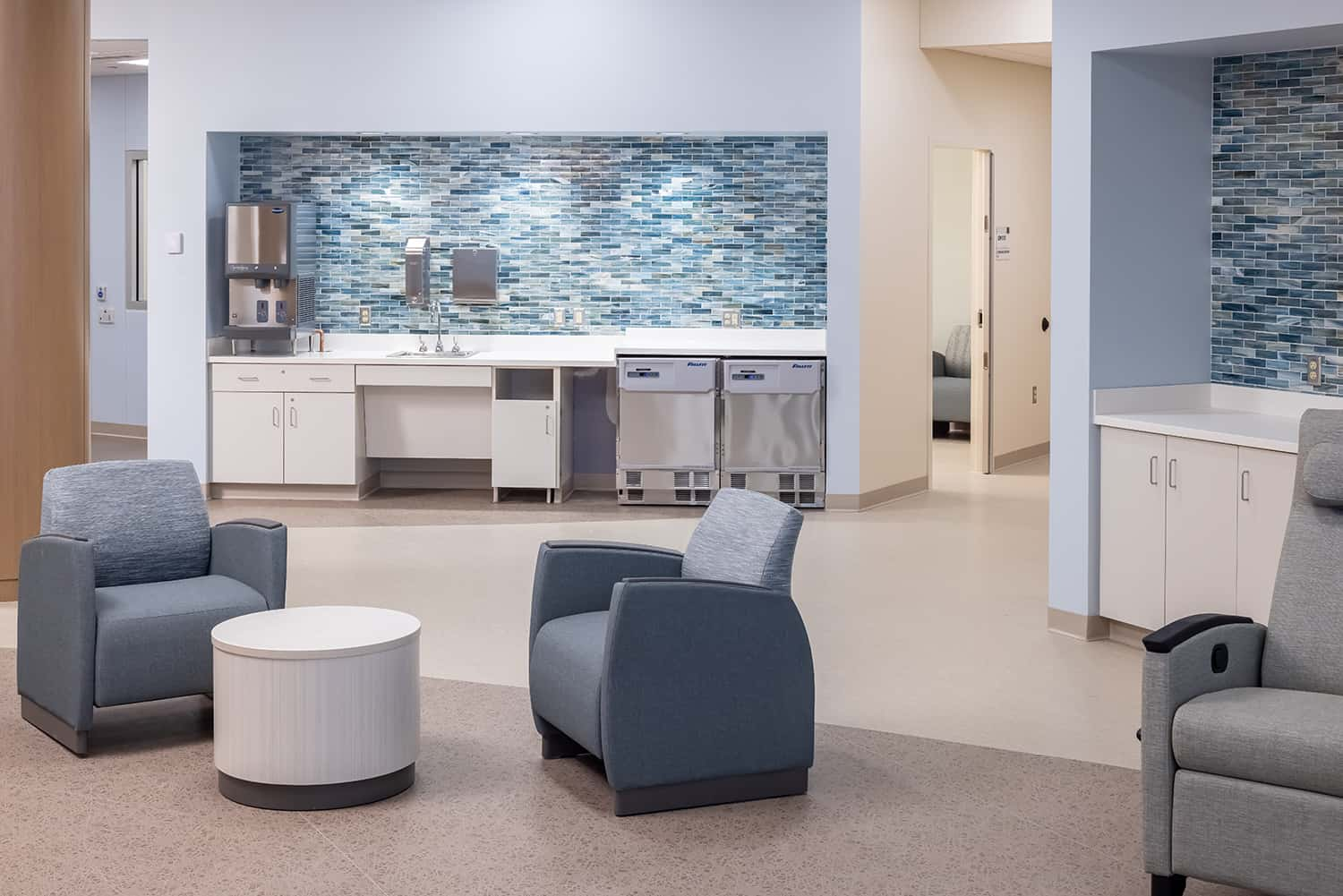View from open seating in the therapy area to the patient refreshment station.