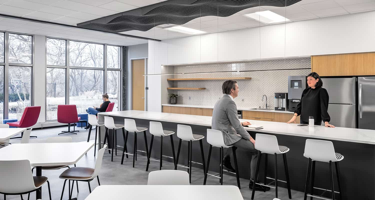 An open work cafe with access to shared coffee station and refrigerators.