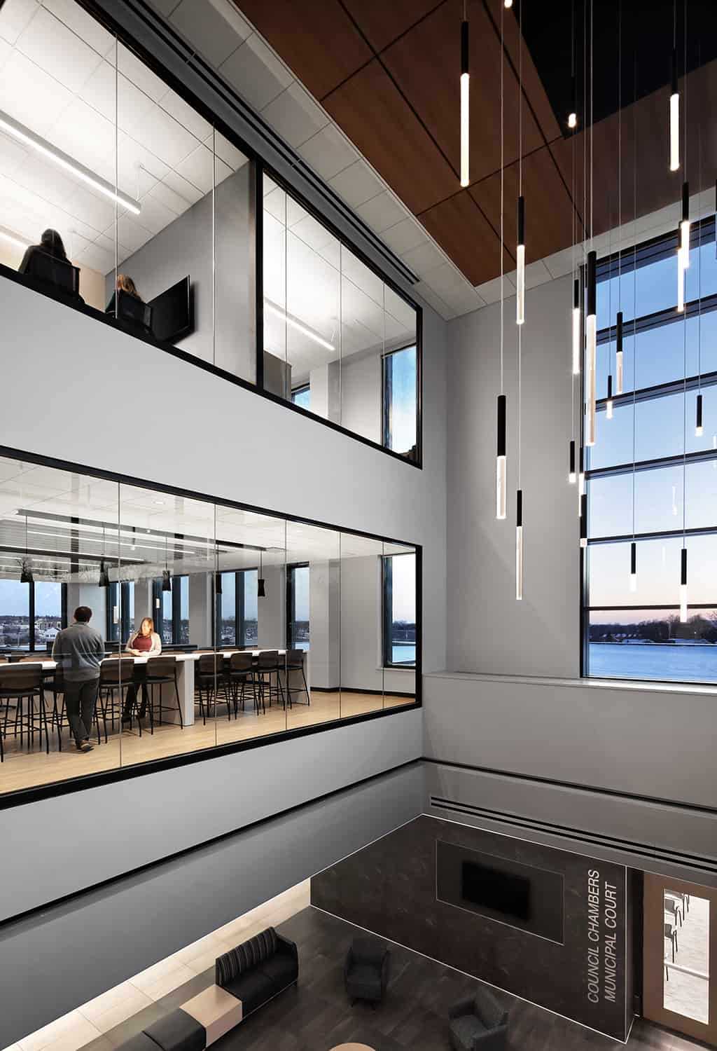 View from atrium into conference rooms and offices above the open space.
