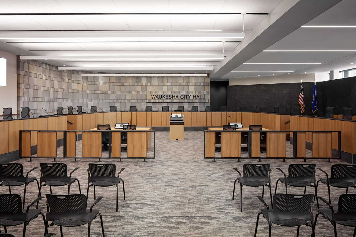 Moveable chairs and spacious seating inside the court room chambers.