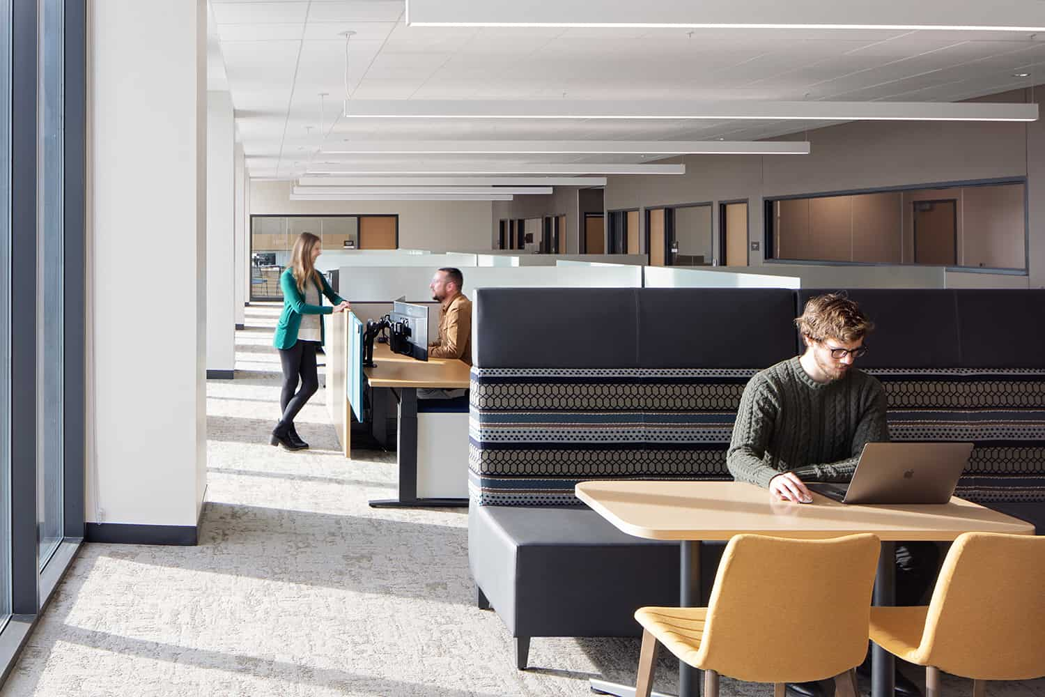 Open office workstations and nearby desks for collaborative work.