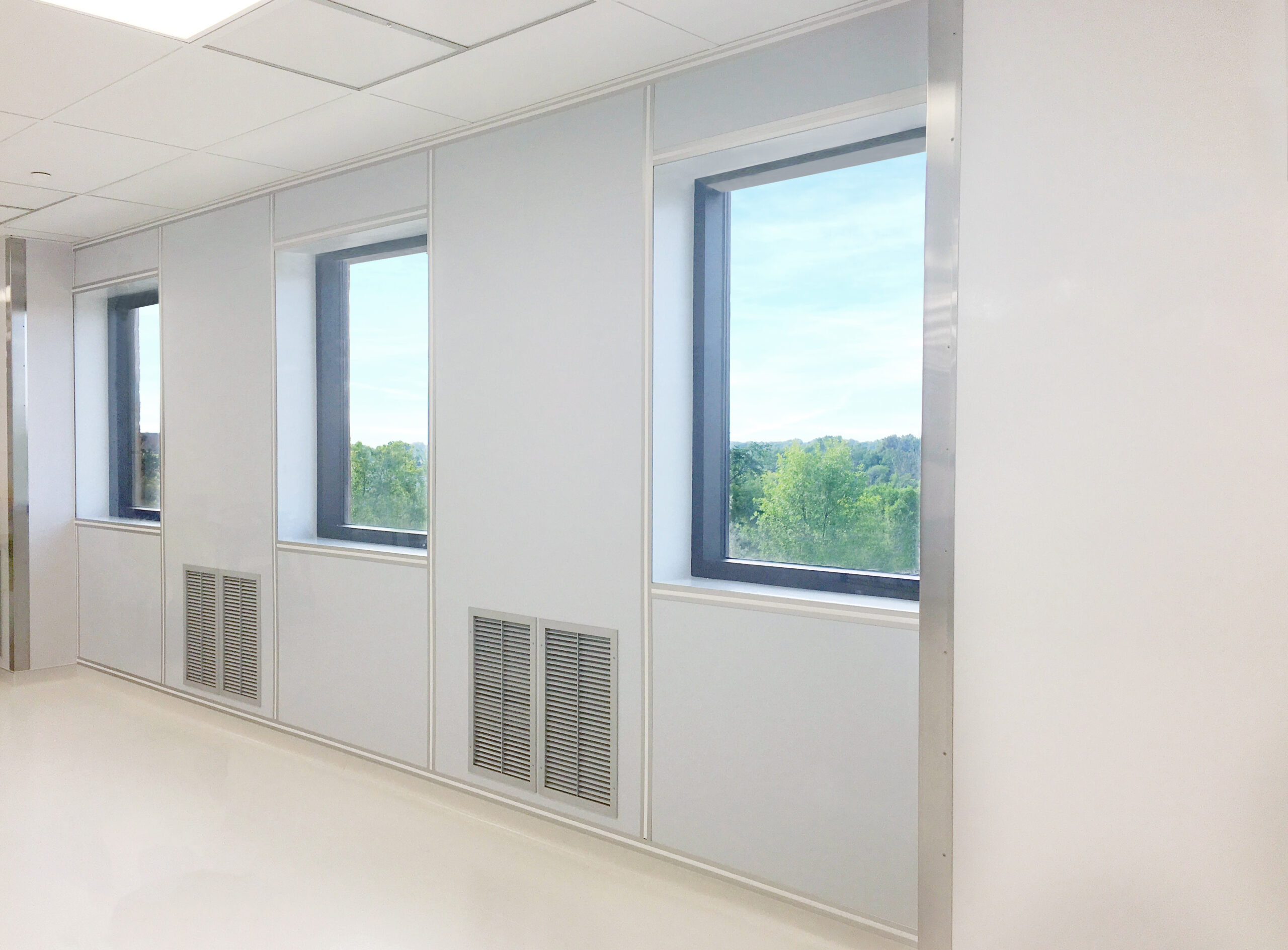 Windows in a cleanroom that offer views to nature for employees.
